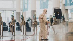 Man disinfects floor against coronavirus